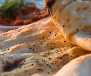 Fresh warm thin Turkish flat bread with sesame seed